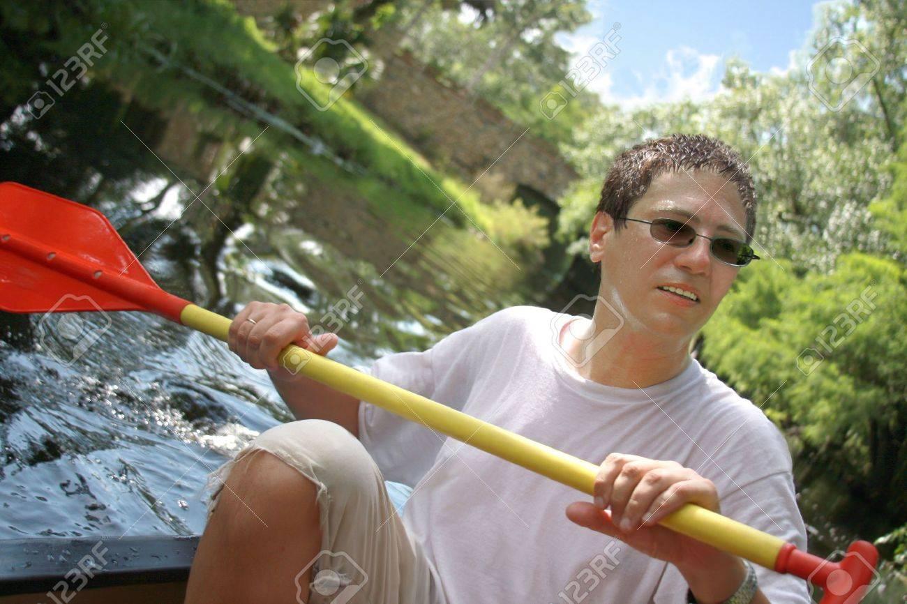 Kayak surfer paddling in rough river Stock Photo - 5149376
