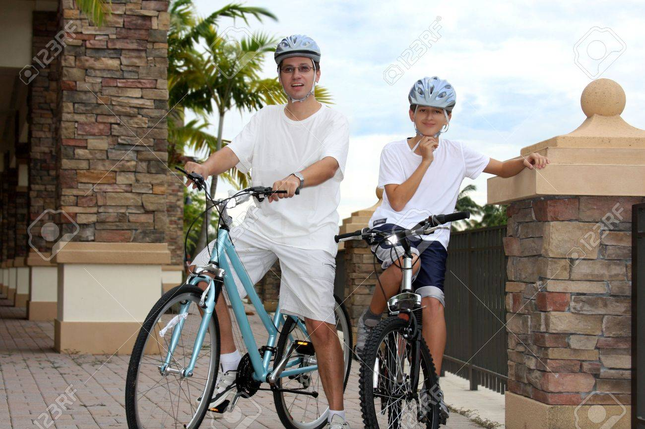 Father and son sitting on bikes Stock Photo - 5518622