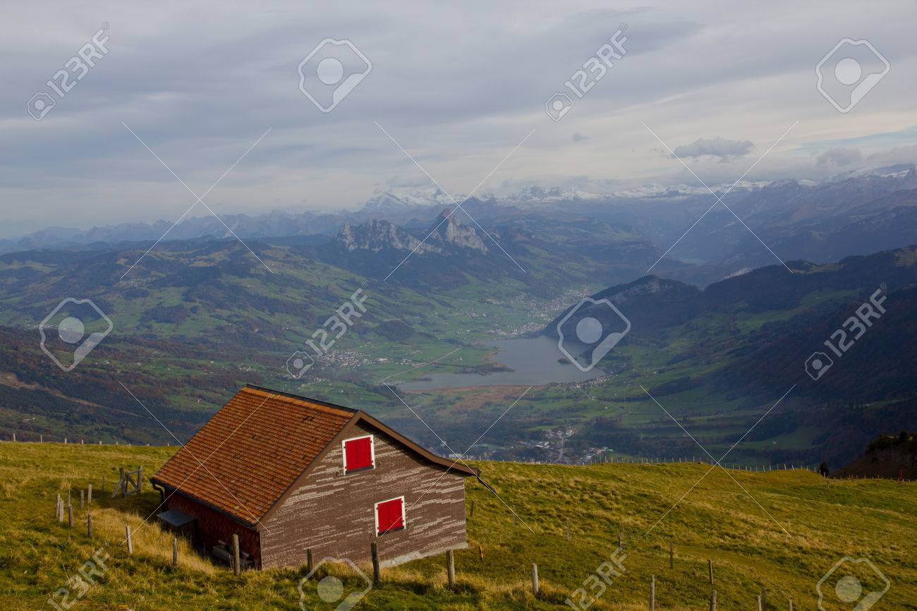 small house on the hill of mt rigi switzerland stock photo picture