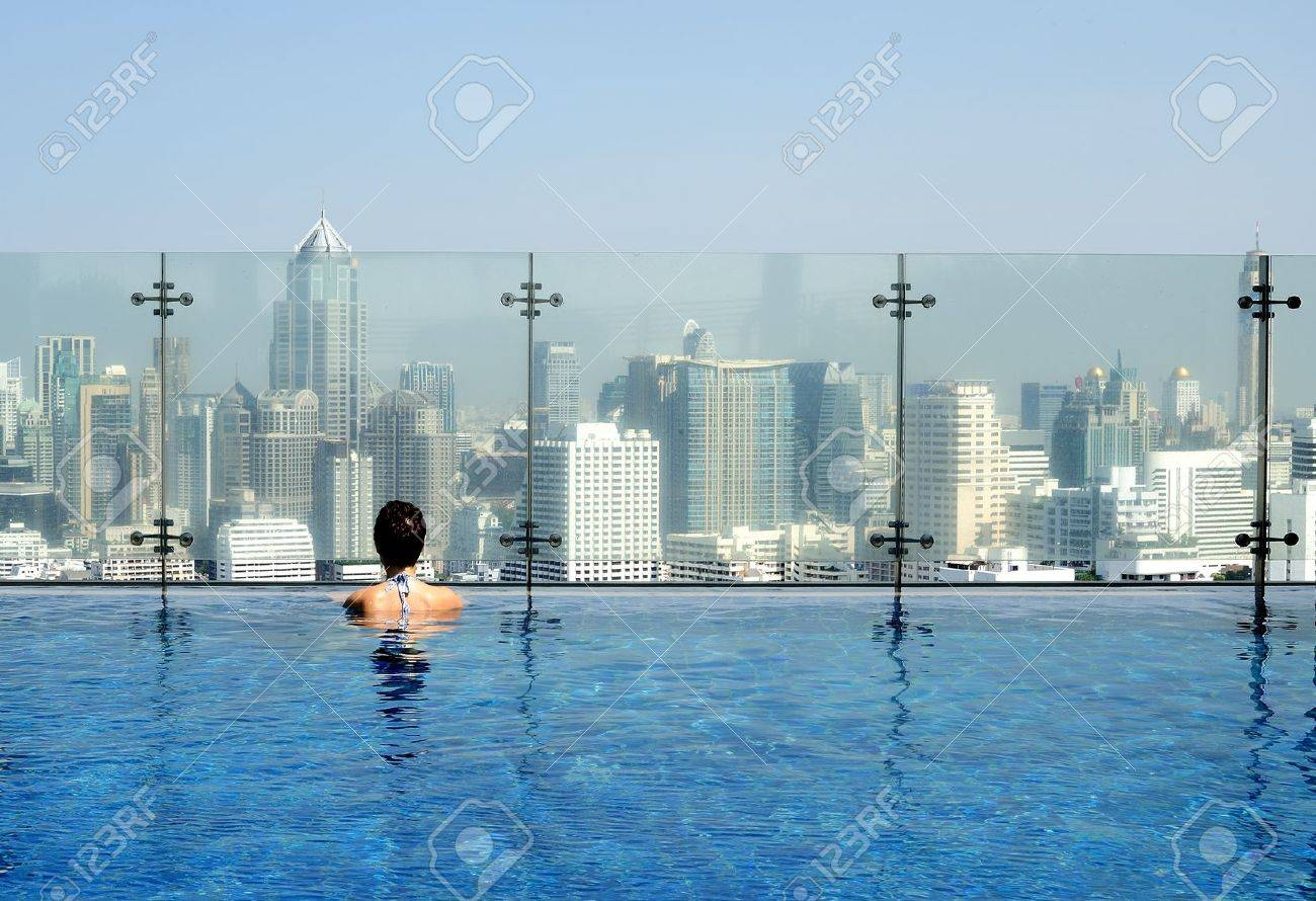 Women In A Swimming Pool On The Roof Admiring A Cityscape Stock Photo Picture And Royalty Free Image Image 13705480