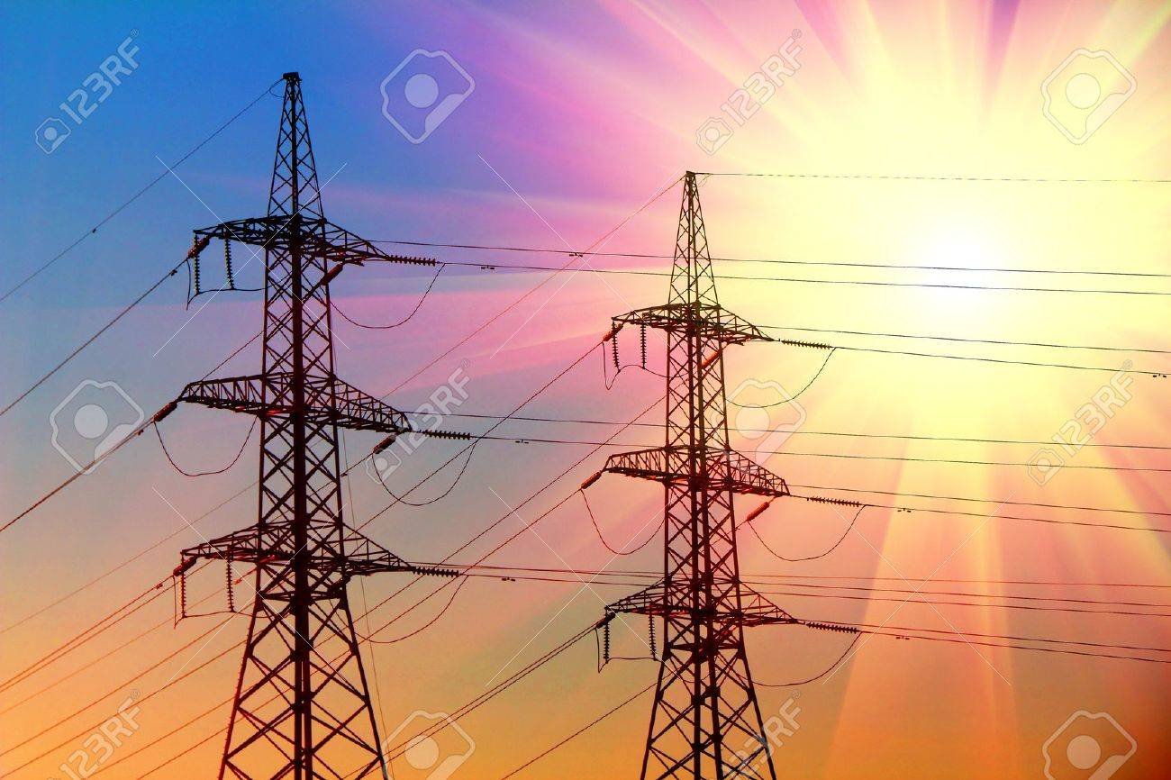 electric power transmission towers at sunset Stock Photo - 9198090