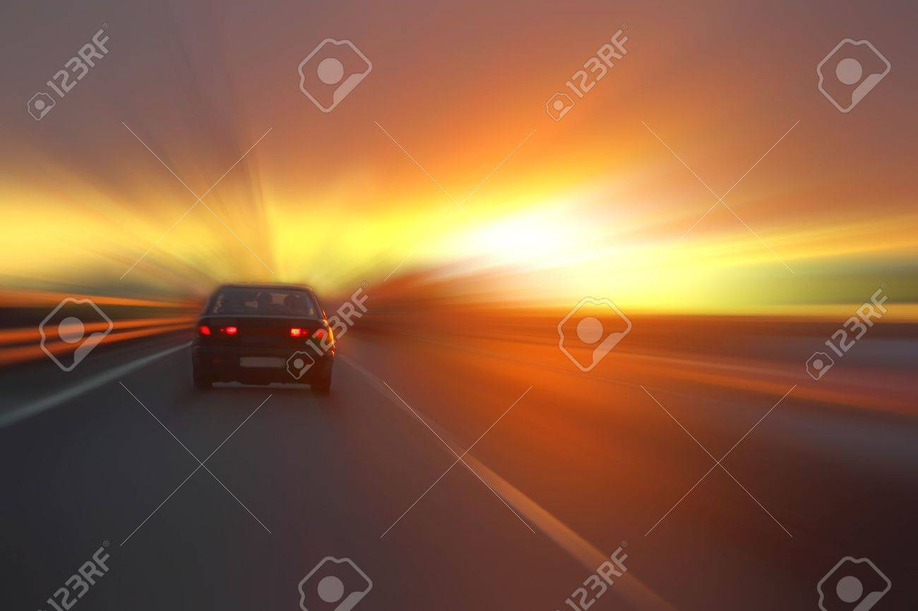 car at sunset on the highway - 10856110