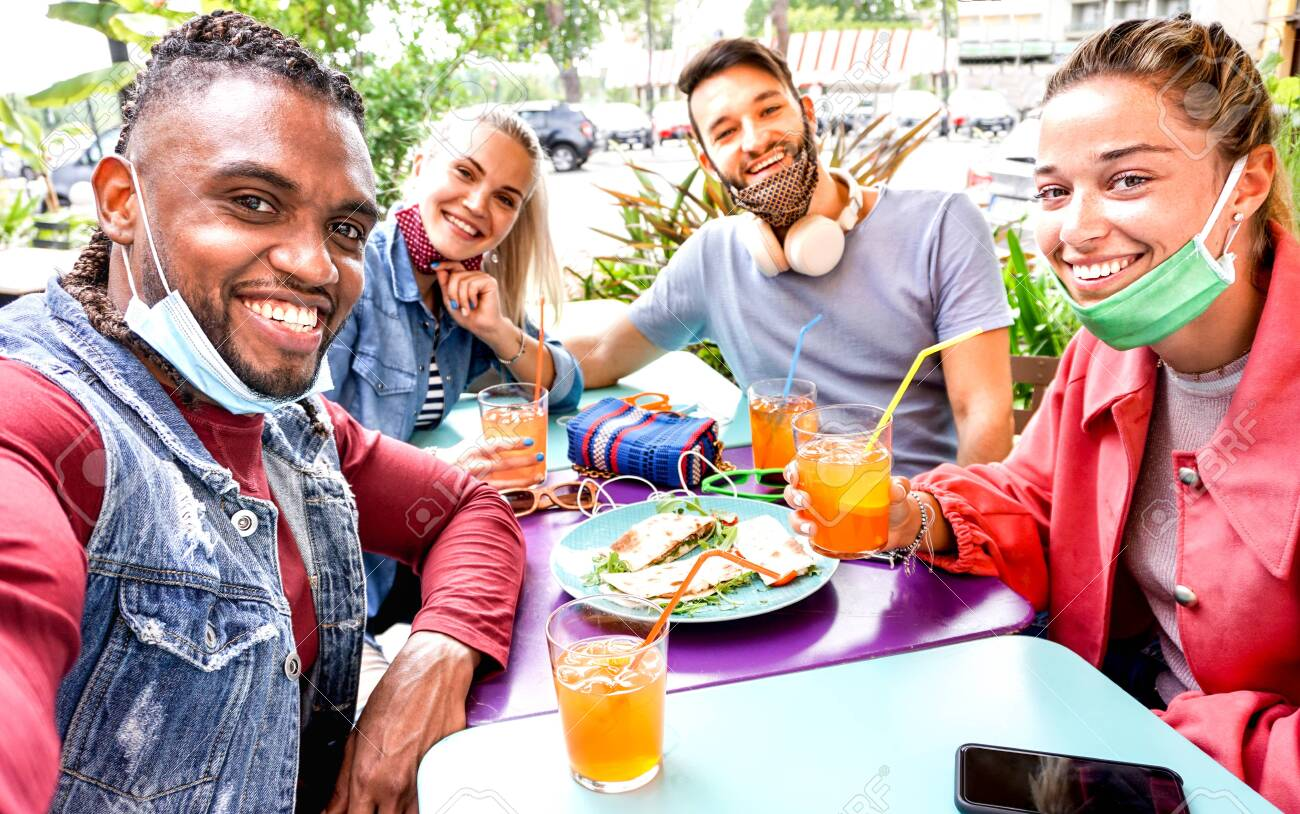Friends taking selfie in a bar restaurant with face mask - 155783865