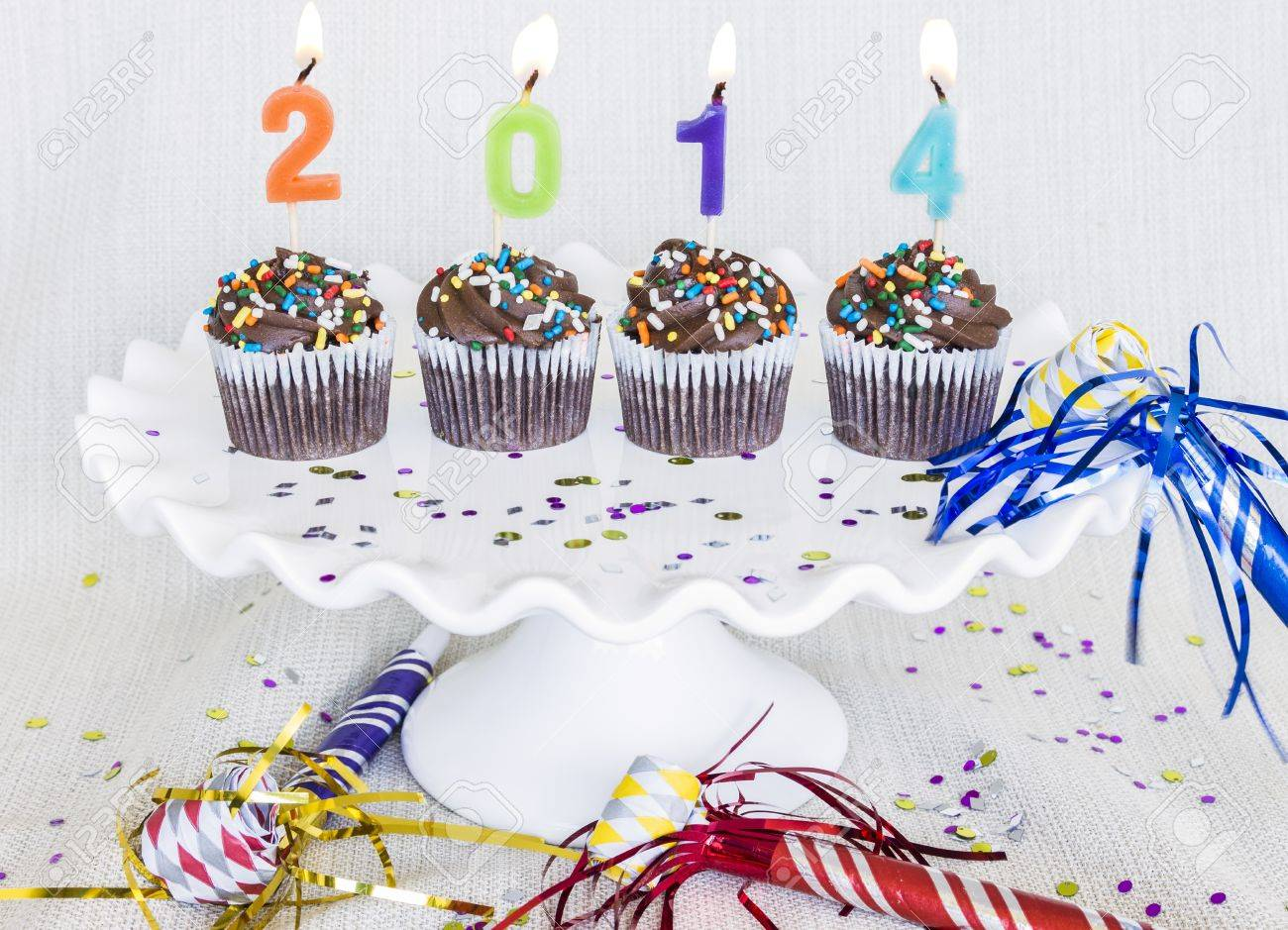 Lit Multicolored Candles That Spell 2014 In Chocolate Mini ...