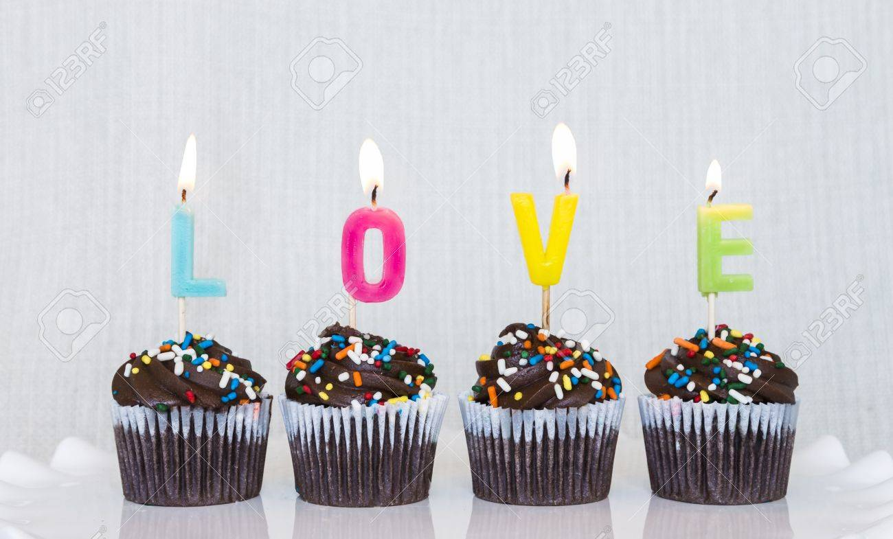 Lit Multicolored Candles That Spell LOVE In Chocolate Mini ...