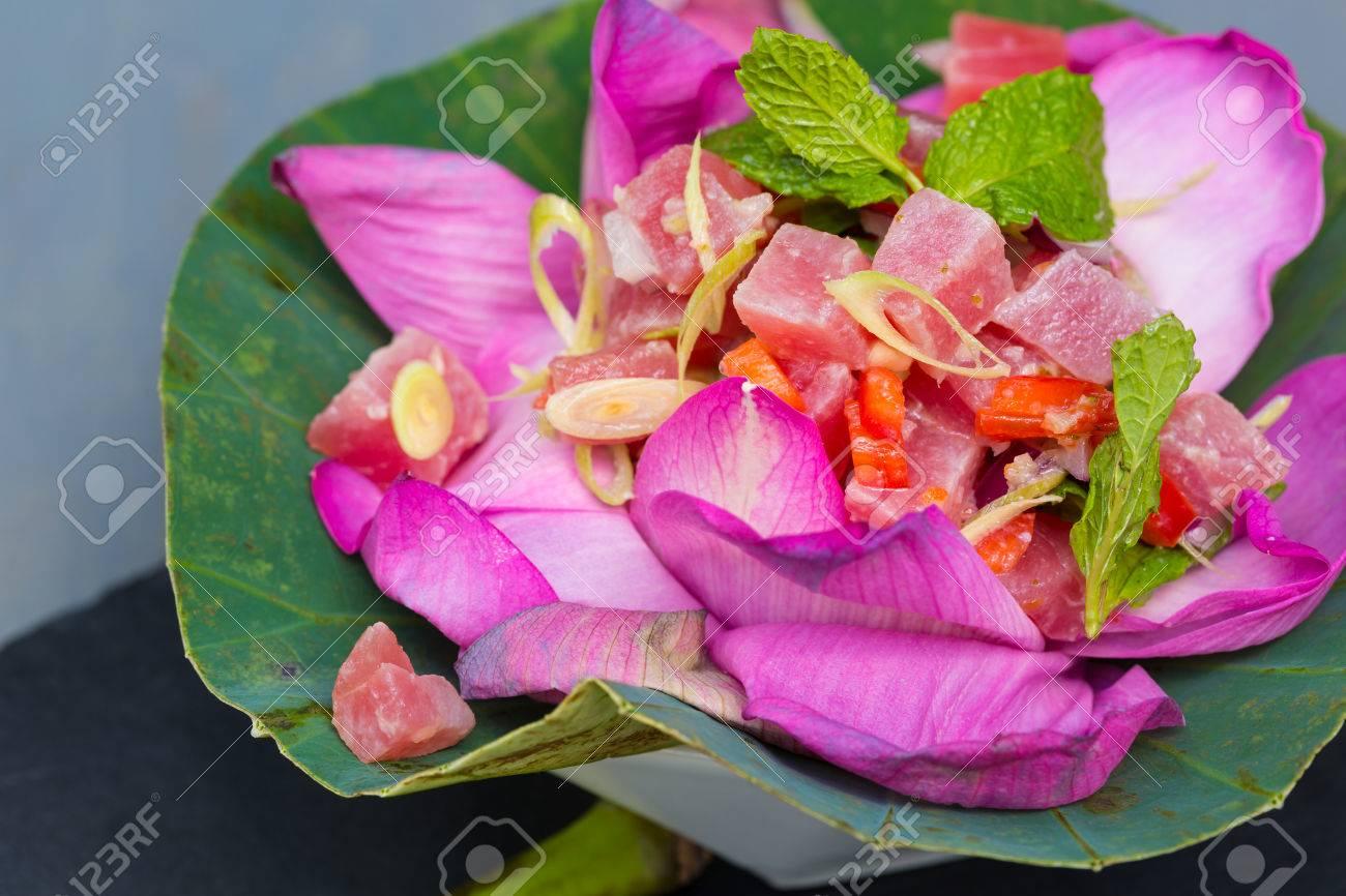 Thai ahi tuna salad served in a beautiful lotus flower stock photo stock photo thai ahi tuna salad served in a beautiful lotus flower izmirmasajfo