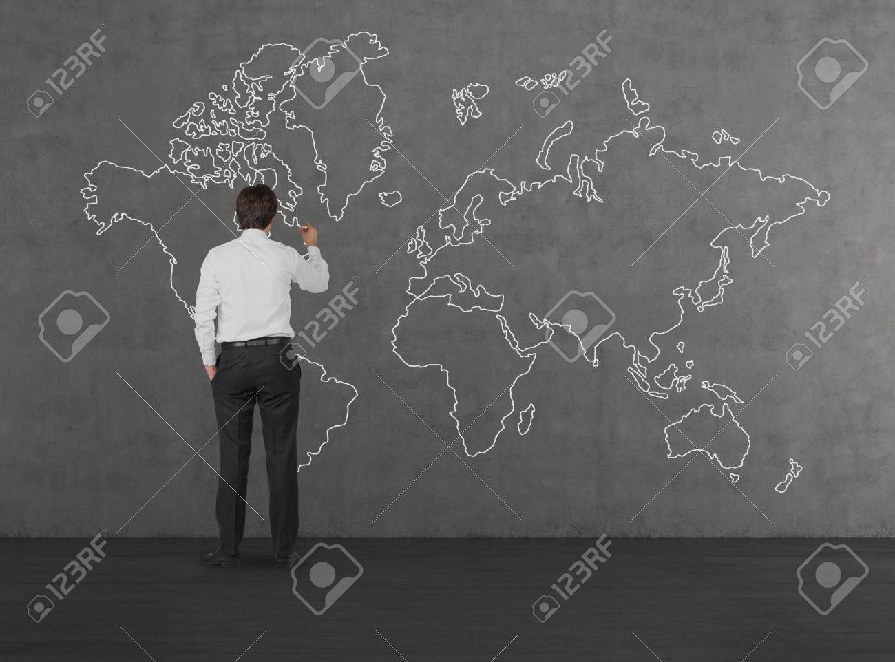Businessman drawing world map on concrete wall stock photo picture businessman drawing world map on concrete wall stock photo 34670086 gumiabroncs Images