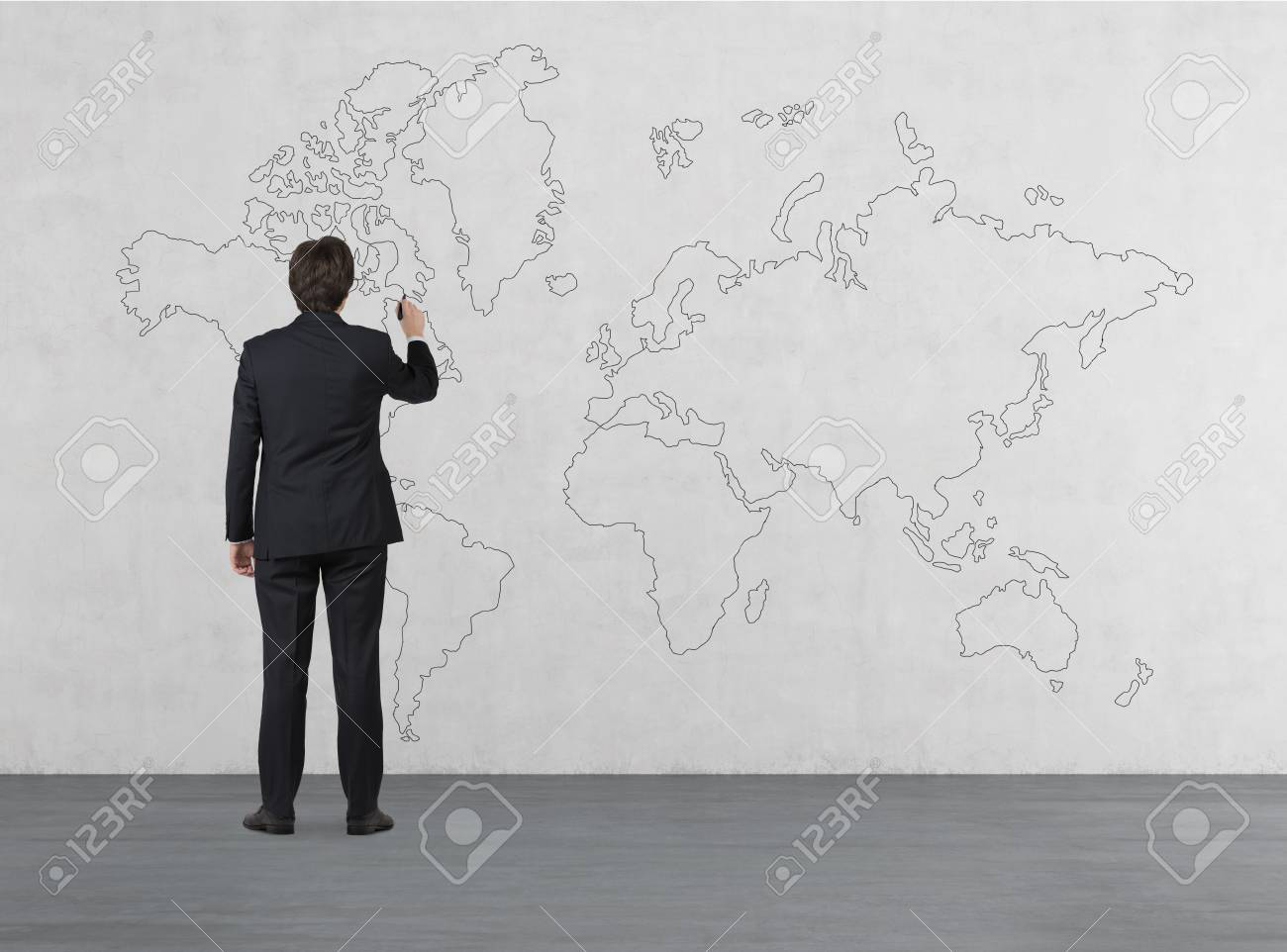 Businessman drawing world map on white concrete wall stock photo businessman drawing world map on white concrete wall stock photo 34842963 gumiabroncs Images
