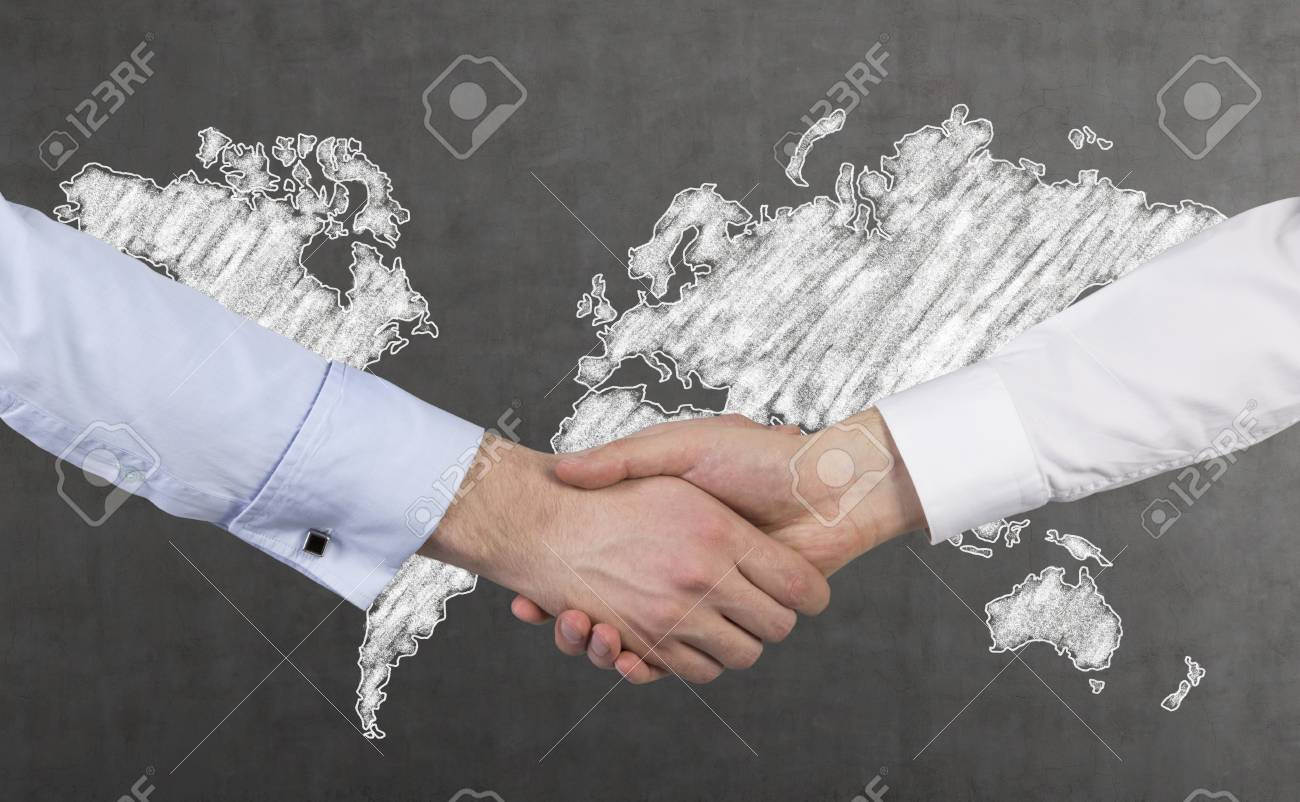 Handshake and drawing world map on wall stock photo picture and handshake and drawing world map on wall stock photo 35376794 gumiabroncs Choice Image