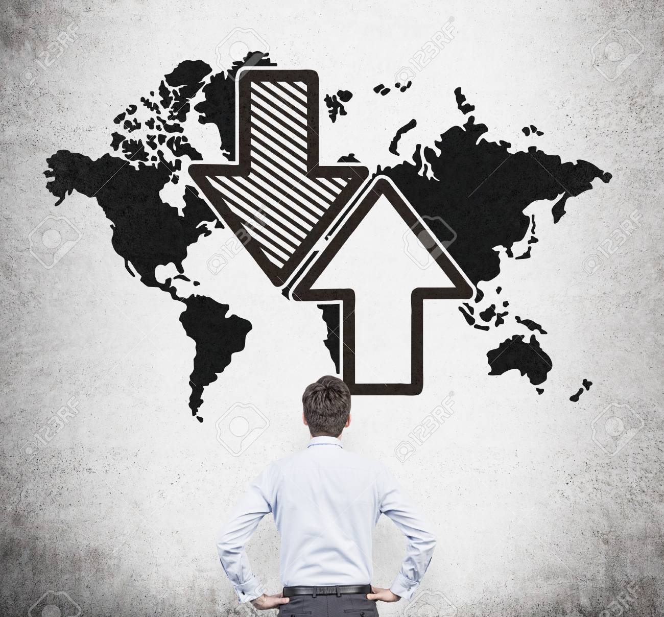 Businessman looking at drawing world map with arrow on gray wall businessman looking at drawing world map with arrow on gray wall stock photo 36741021 gumiabroncs Choice Image