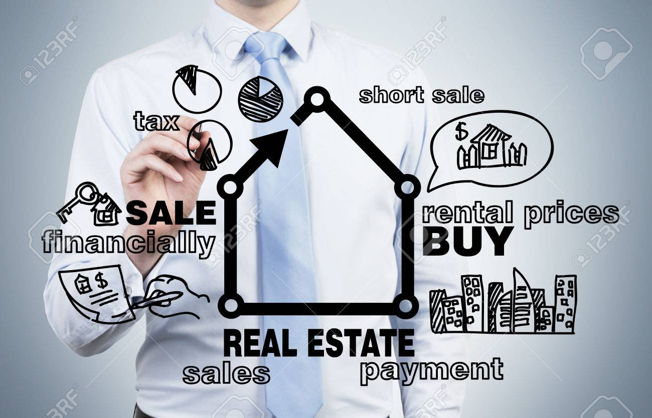 businessman drawing real estate concept on blue background - 37584810