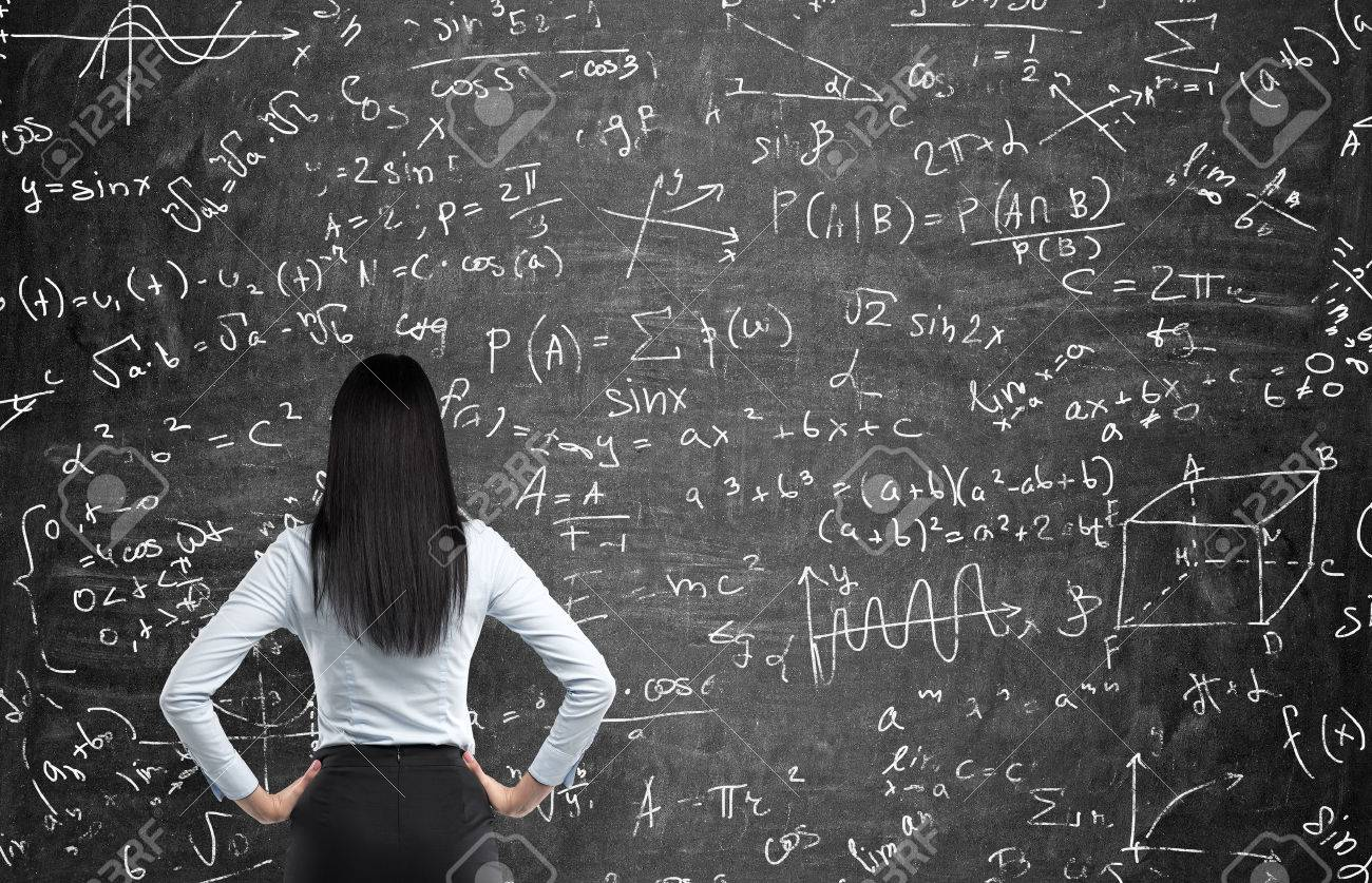 rear view of a thoughtful woman who tries to solve math problems