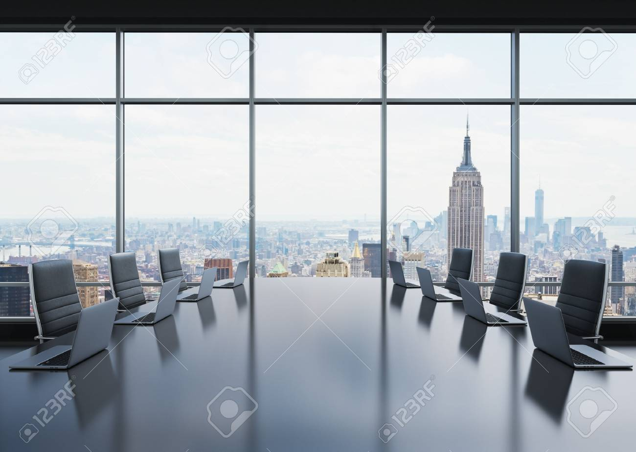 A conference room equipped by modern laptops in a modern panoramic