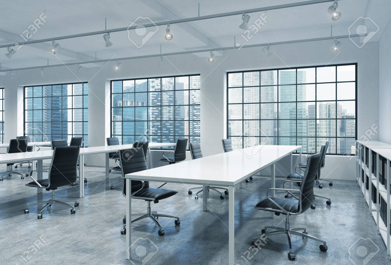 Workplaces in a bright modern loft open space office empty tables