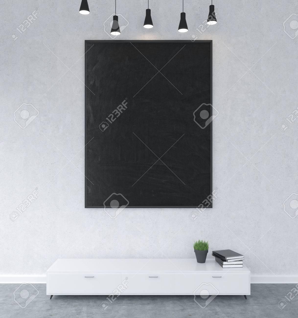 Ein Großer Schwarzer Rahmen An Der Wand über Einem Regal, Bücher Und ...