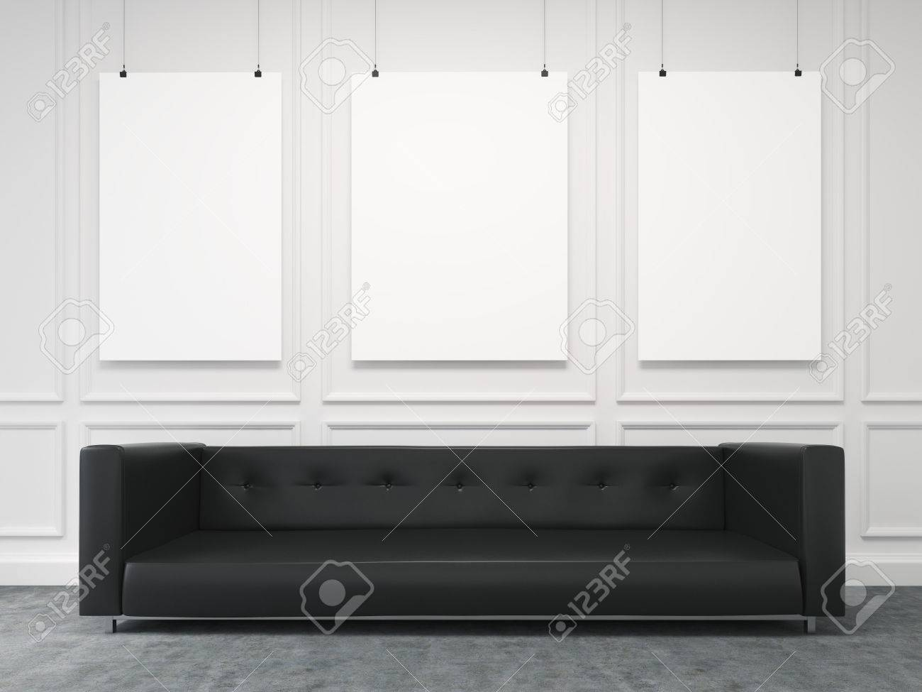 A Long Black Sofa Standing At The White Wall, Three Blank Frames ...