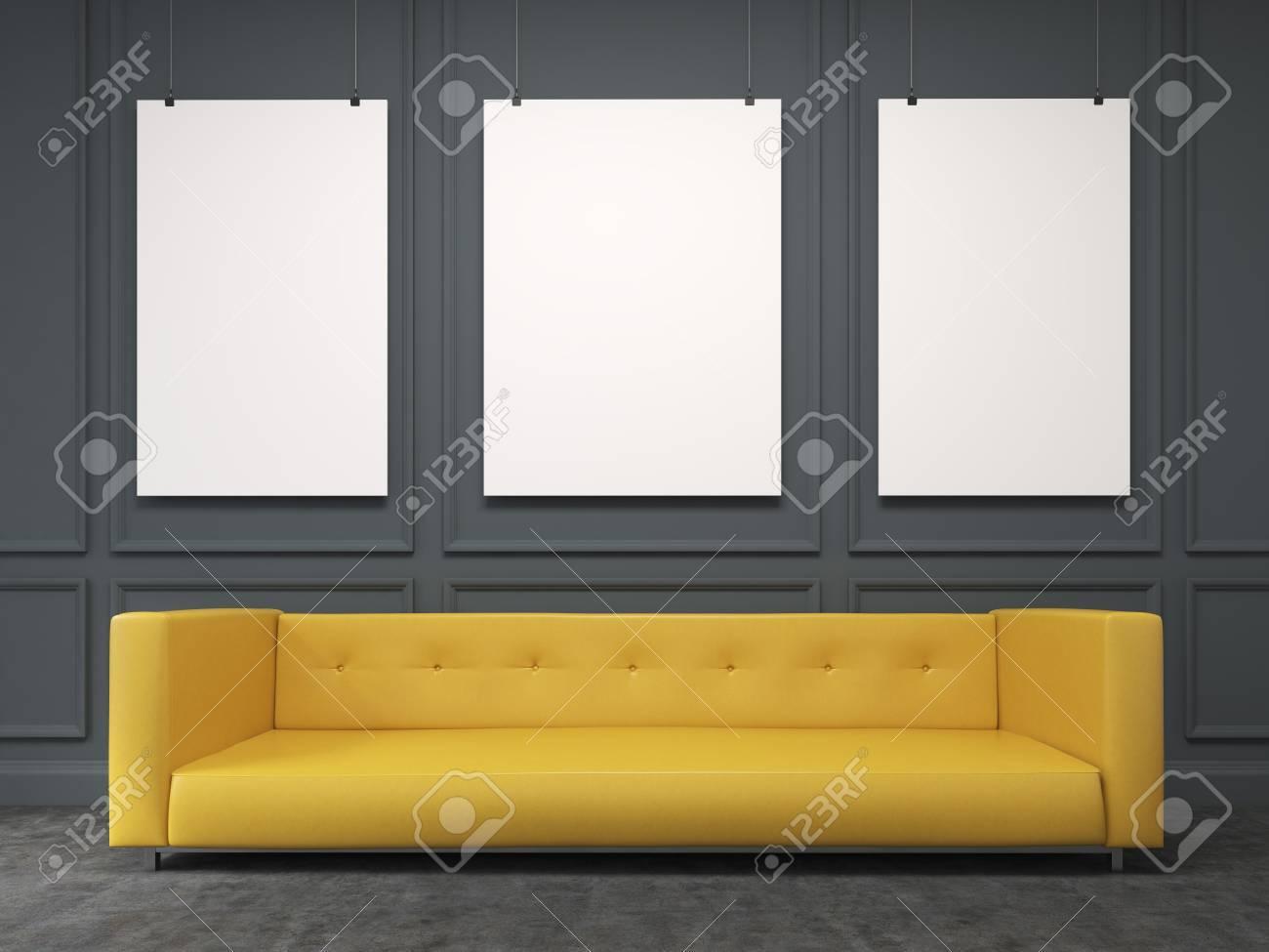 A Long Yellow Sofa Standing At The Black Wall, Three Blank Frames ...