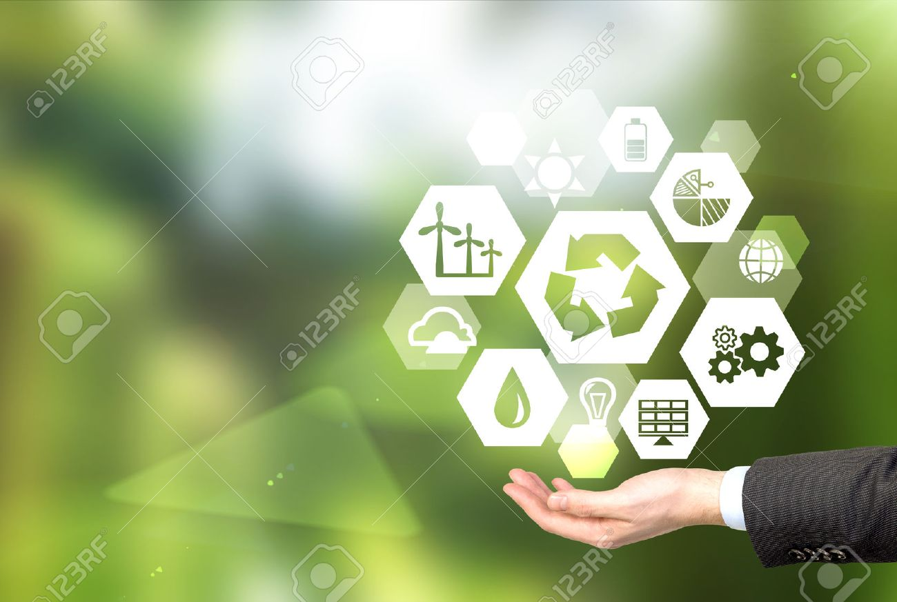 hand holding signs of different green sources of energy in hexahedron shape, a 'reduce, reuse, recycle' sign in the centre. Blurred green background. Concept of clean environment. - 51594041