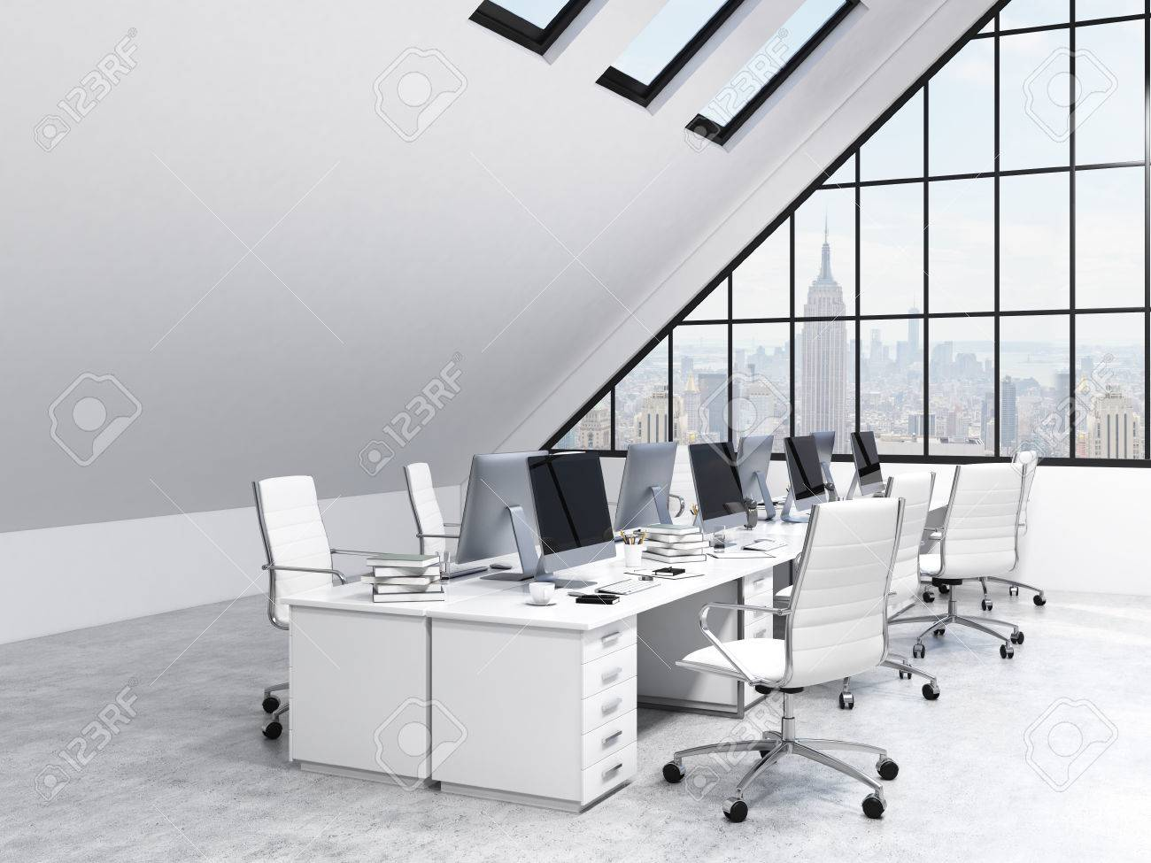 two rows of tables leading to the panoramic window in an office