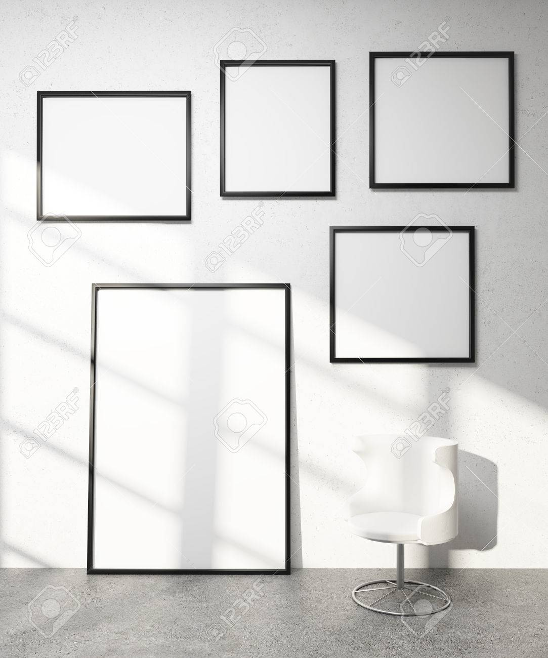 Five frames on white wall, white armchair. Concept of exhibition...
