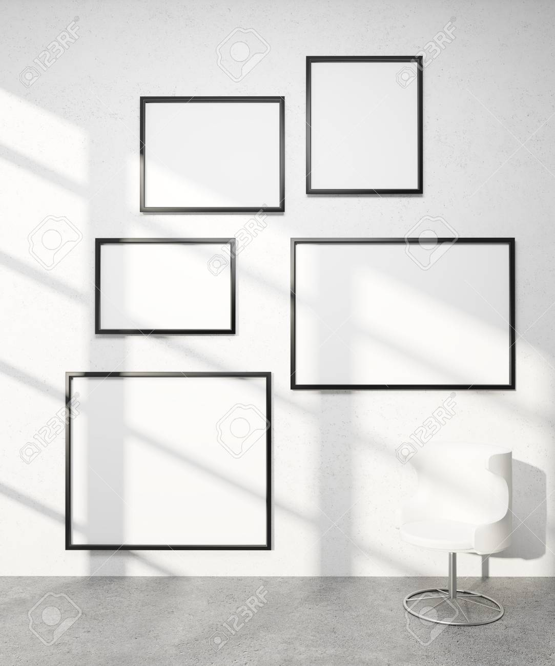 Five Frames Of Different Sizes On White Wall, White Armchair ...