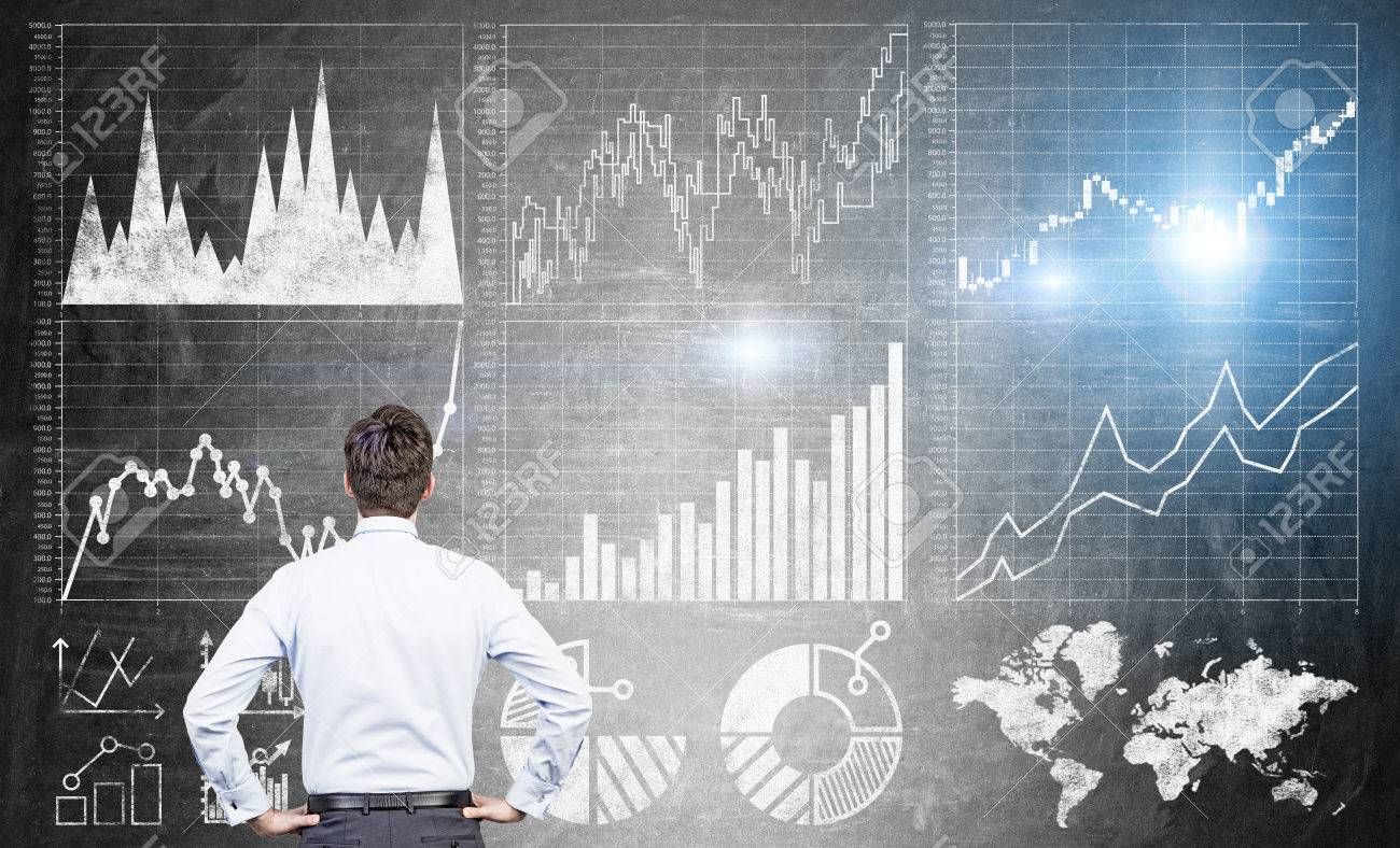 Research concept with businessman looking at forex charts on dark grey concrete wall - 54962306