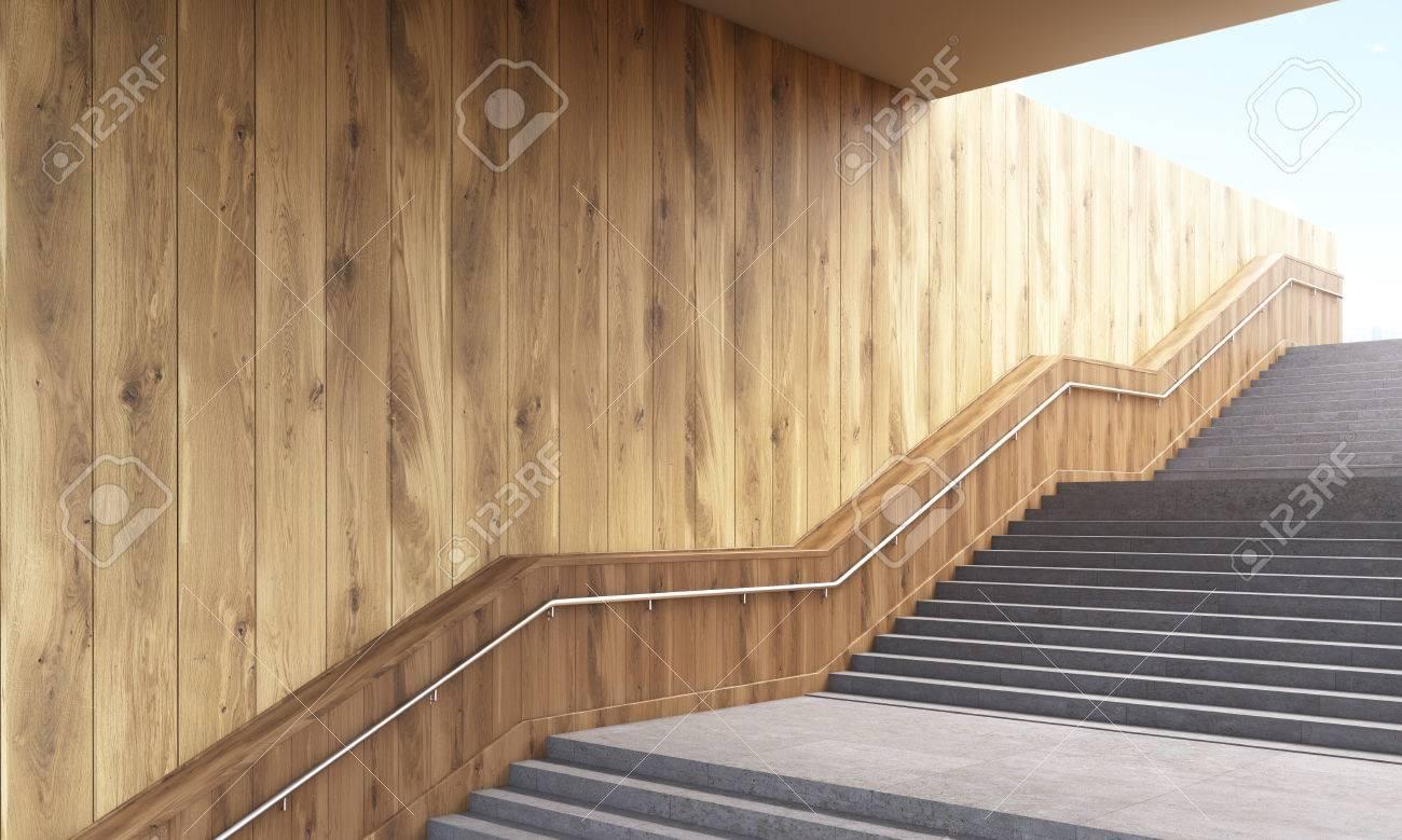 Vista Lateral De La Escalera Con Barandilla Y La Pared De Tablones