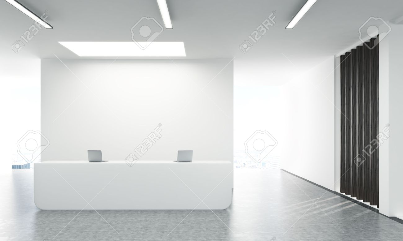 Front view of concrete office lobby with laptops on white reception stand and blank wall behind. 3D Rendering - 57793387
