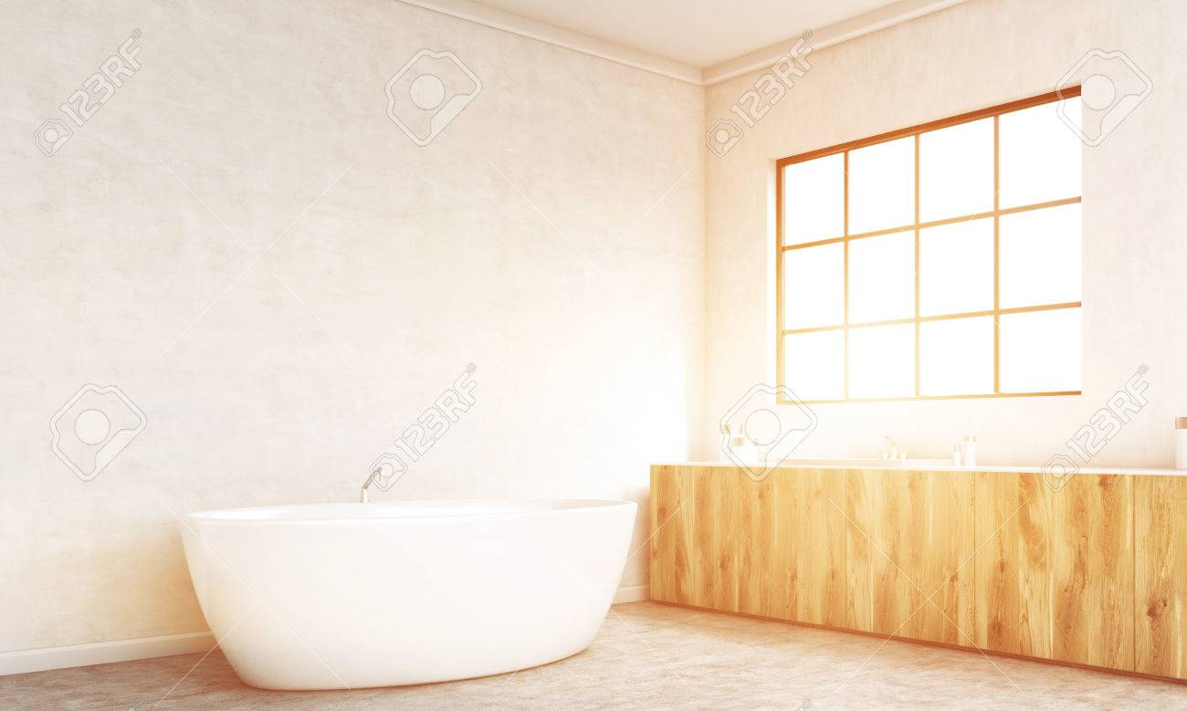 side view of concrete bathroom interior with bathtub, wooden