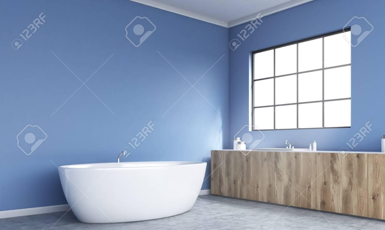 Vue de côté de l\'intérieur de la salle de bain bleu avec baignoire,  comptoirs en bois et fenêtre encadrée. Rendu 3D
