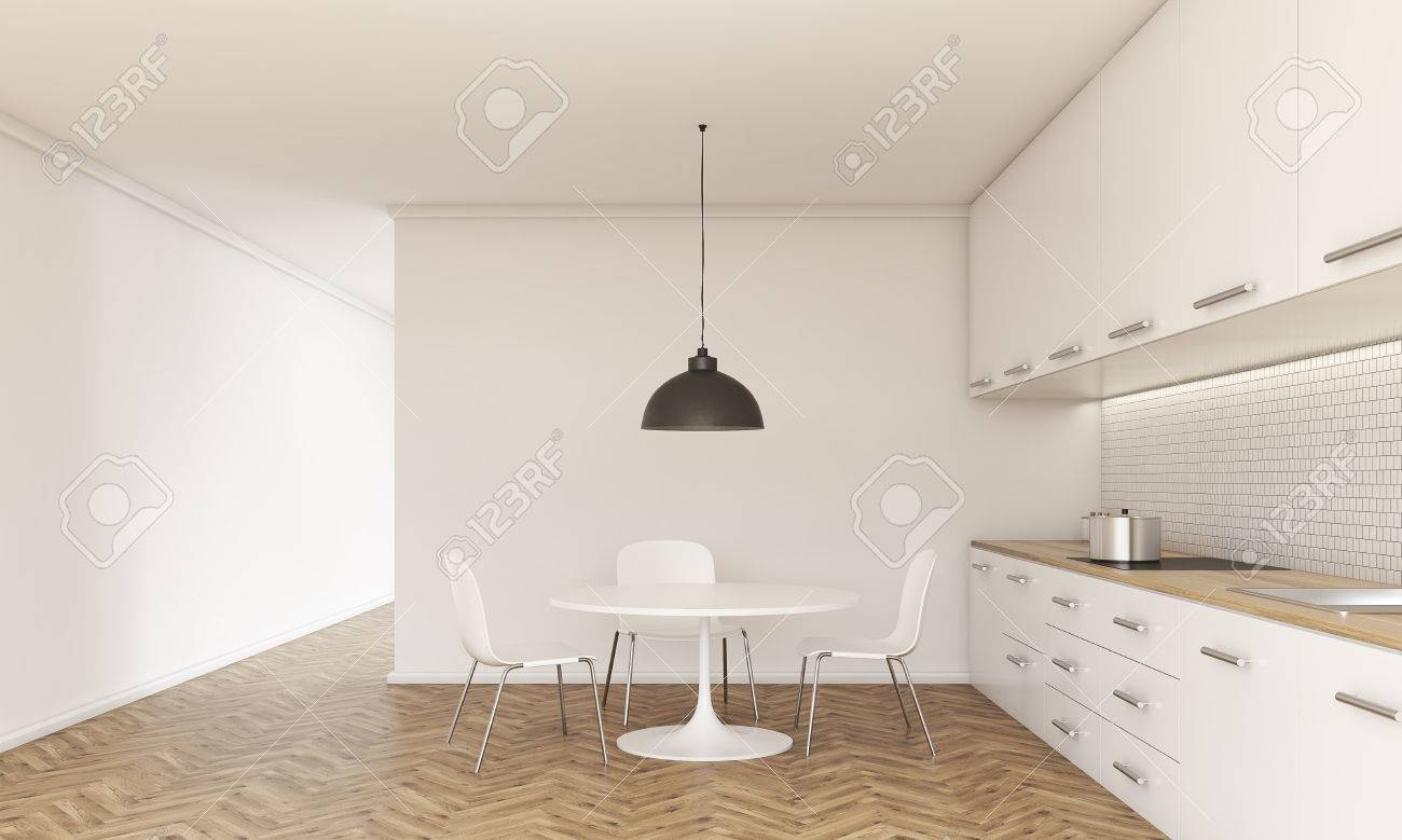 Picture of: Front View Of Kitchen Interior With Small Dining Table And Chairs Stock Photo Picture And Royalty Free Image Image 59651773