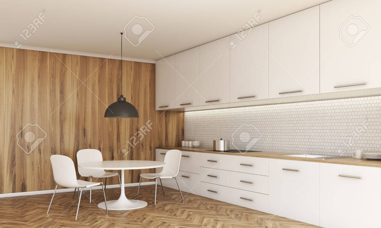 Vista Lateral De Entre Cocina Con Una Pequeña Mesa De Comedor Y ...
