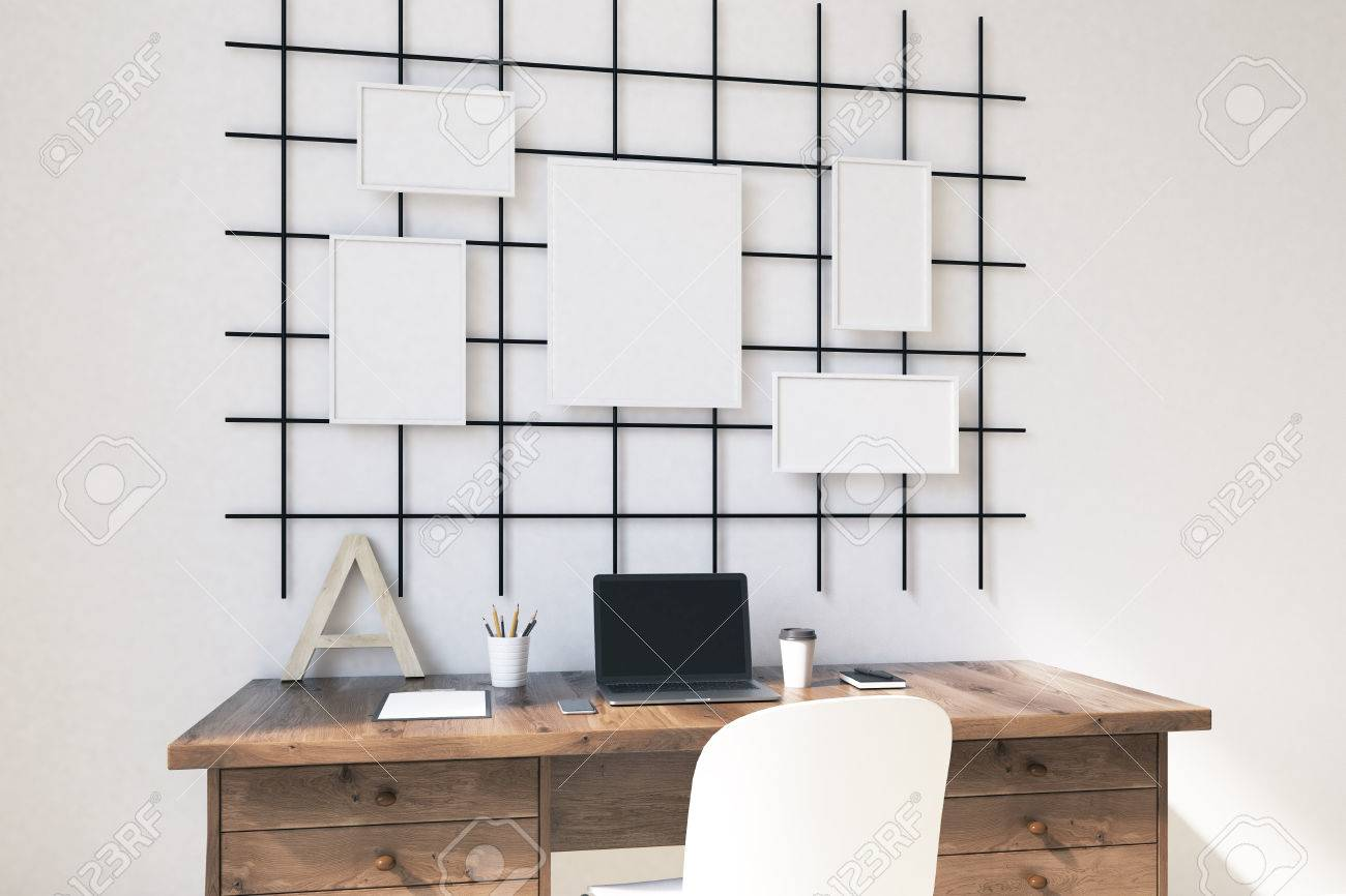 homw office in modern house with posters on wall computer on