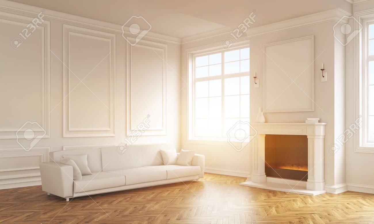 Cadre Au Dessus Du Canapé vue de côté de l'intérieur classique du salon avec des murs en béton,  plancher en bois, canapé blanc et un cadre photo blanc au-dessus de la  cheminée.