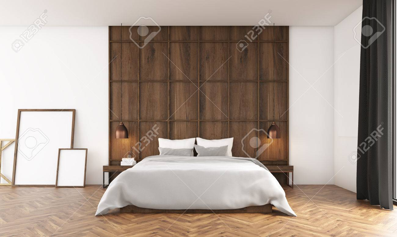 Bedroom with big window and wooden wall. Posters standing near..