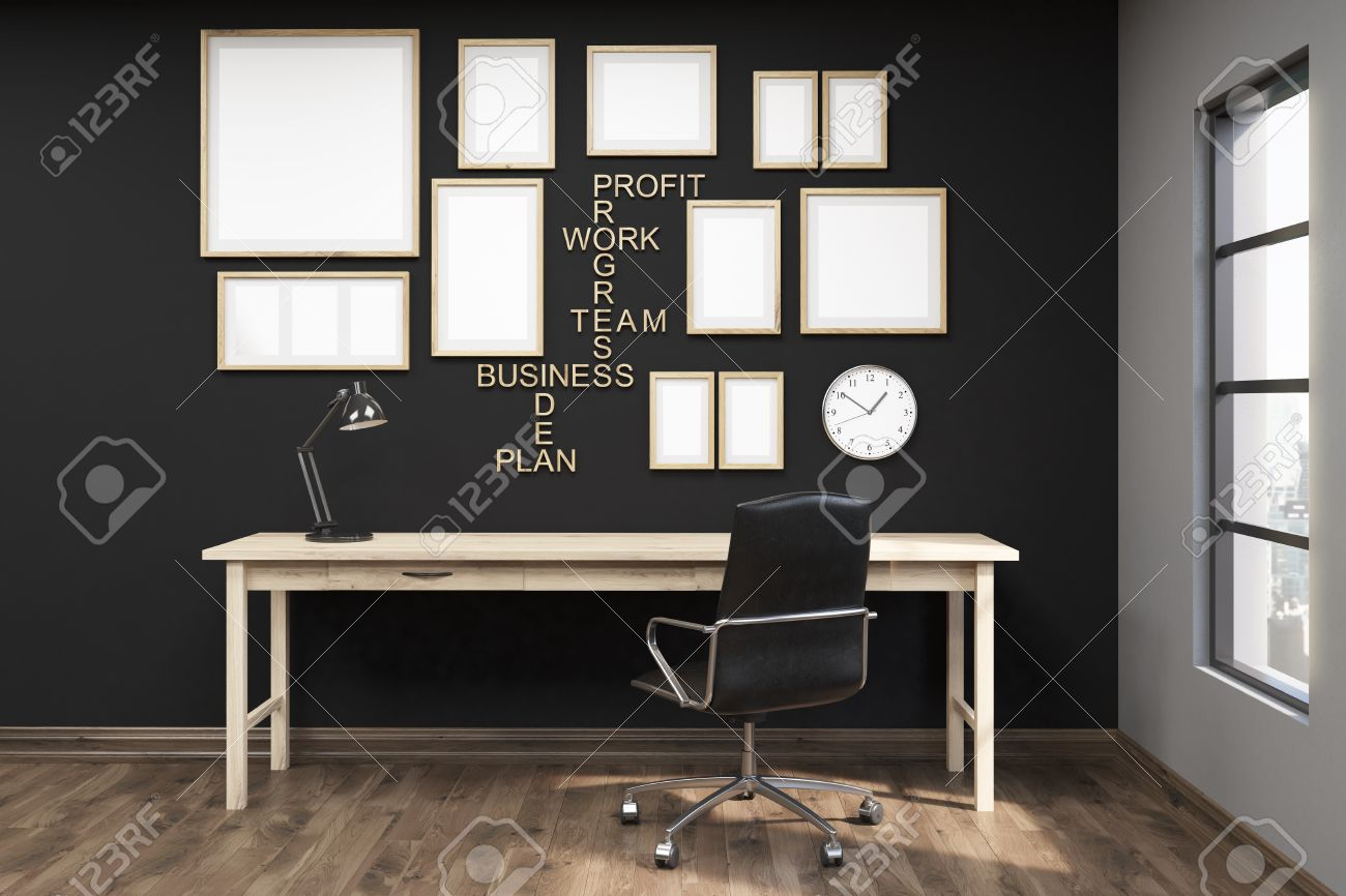 wall office desk. Multiple Posters In Frames On Black Wall Of Home Office. Wooden Floor. Comfortable Writing Office Desk E