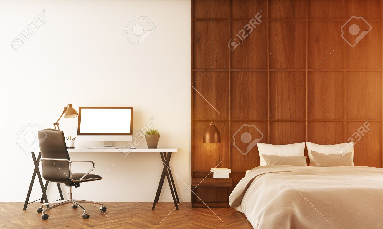 Cosy Bedroom With Large Bed And A Writing Desk In Modern House. Computer On  Table