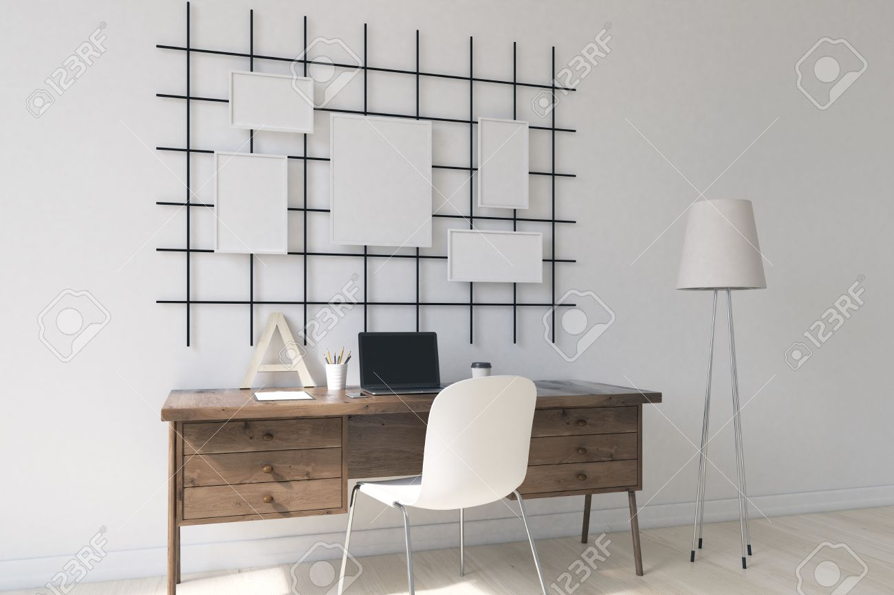 Modern Working Space In White Room. Posters On Wall. Computer On Table.  Cosept