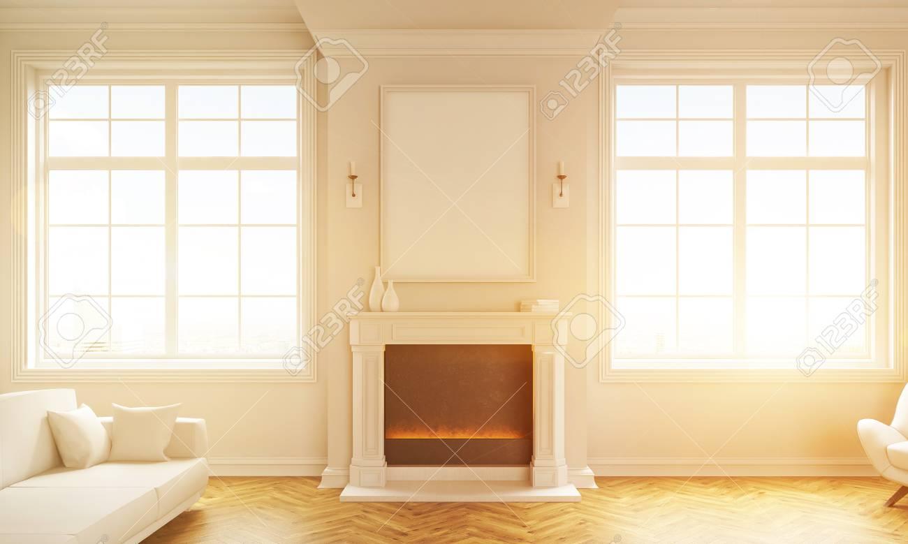 Cadre Au Dessus Du Canapé vue de face de l'intérieur du salon classique avec fenêtres, plancher en  bois, canapé blanc et cadre photo blanc au-dessus du foyer. image tonique