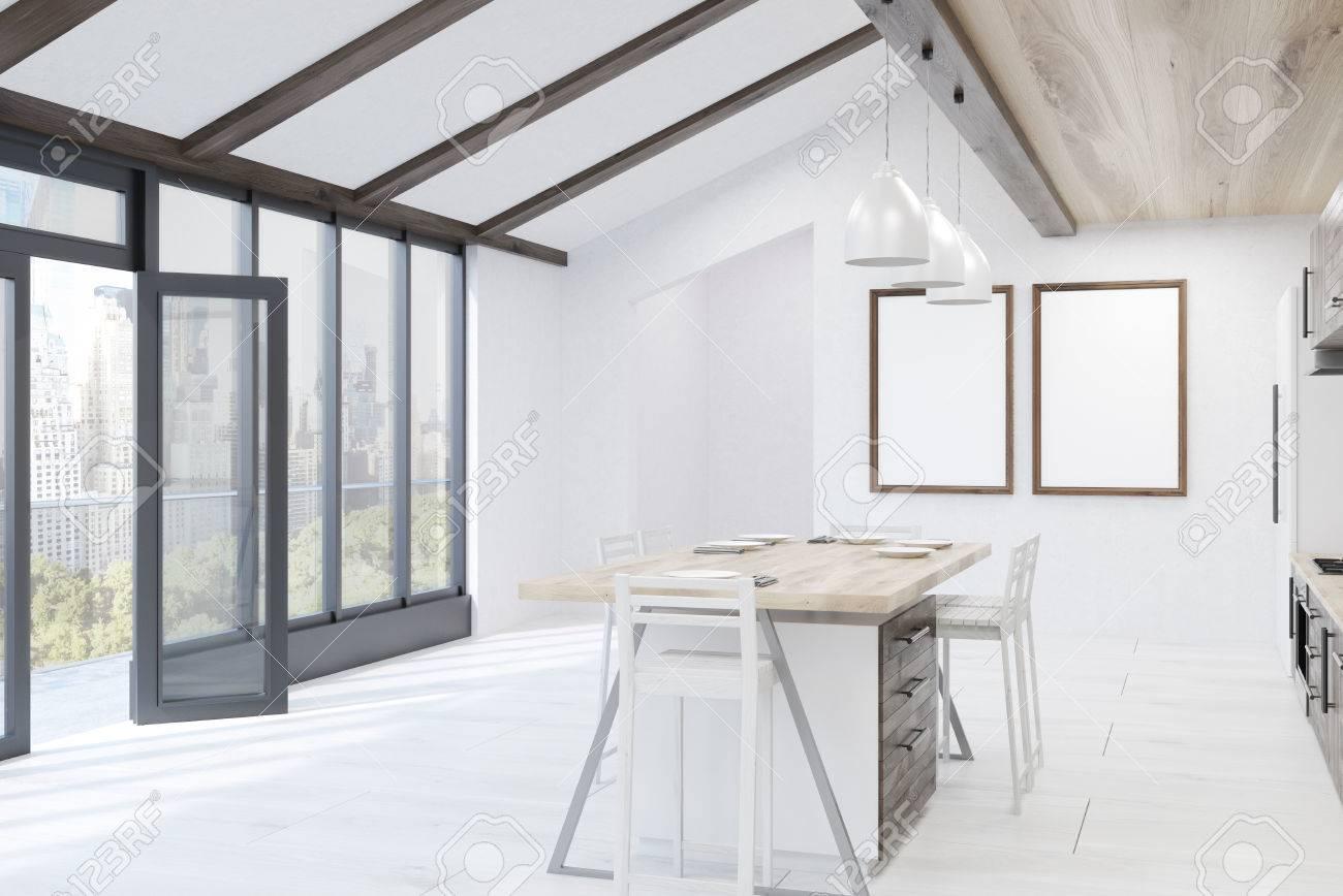 Interior De La Cocina Moderna Con Mesa De Comedor, Balcón Y Carteles ...