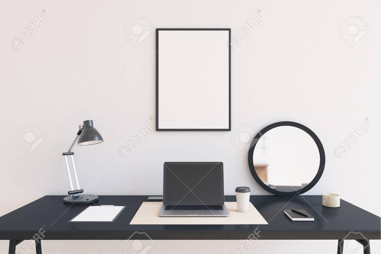 Laptop In Der Mitte Der Tabelle. Lampe Und Spiegel An Den Seiten. Großes  Plakat In Rahmen Auf Weiße Wand. Konzept Der Arbeit Zu Hause. 3D Rendering.