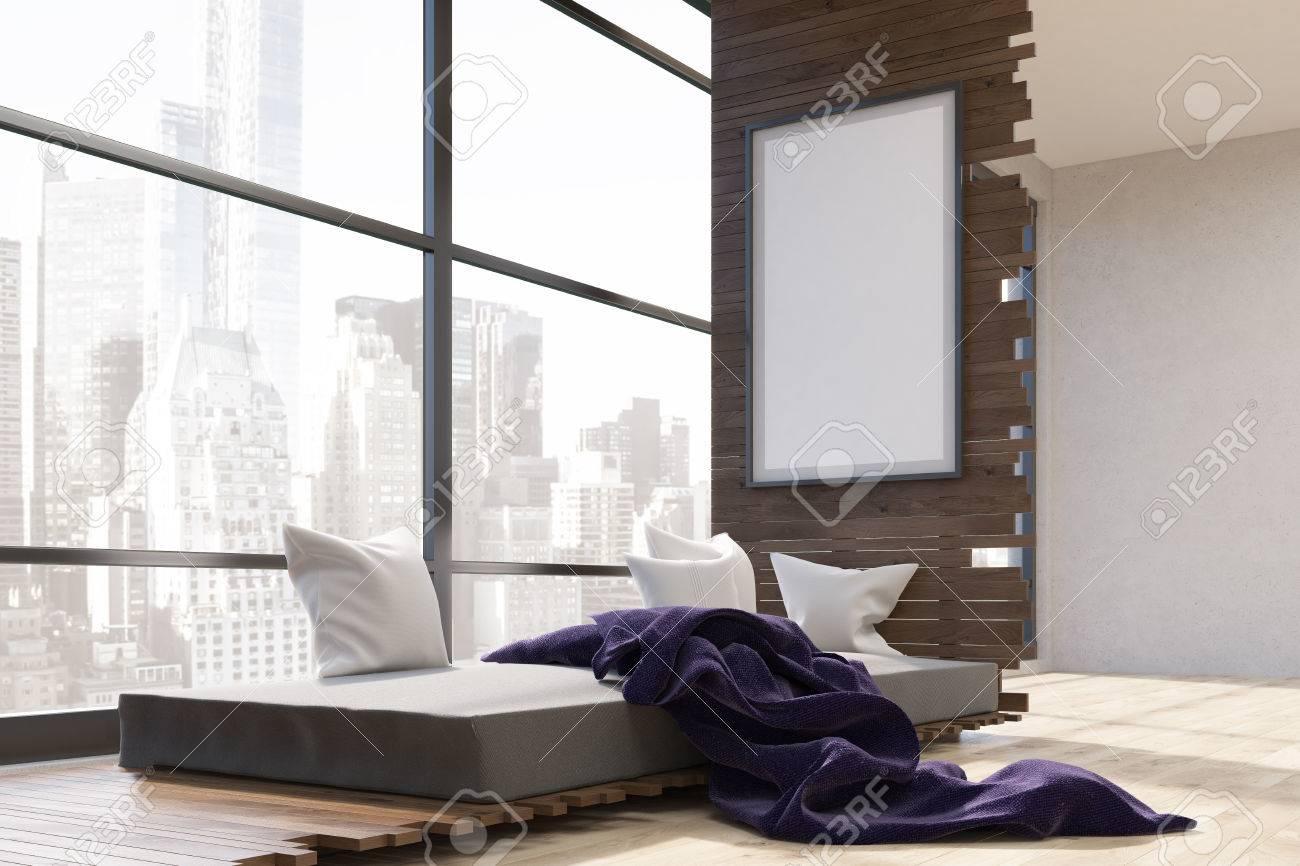 Letto Modello Viola : Interiore della stanza in città grande con letto coperta viola e