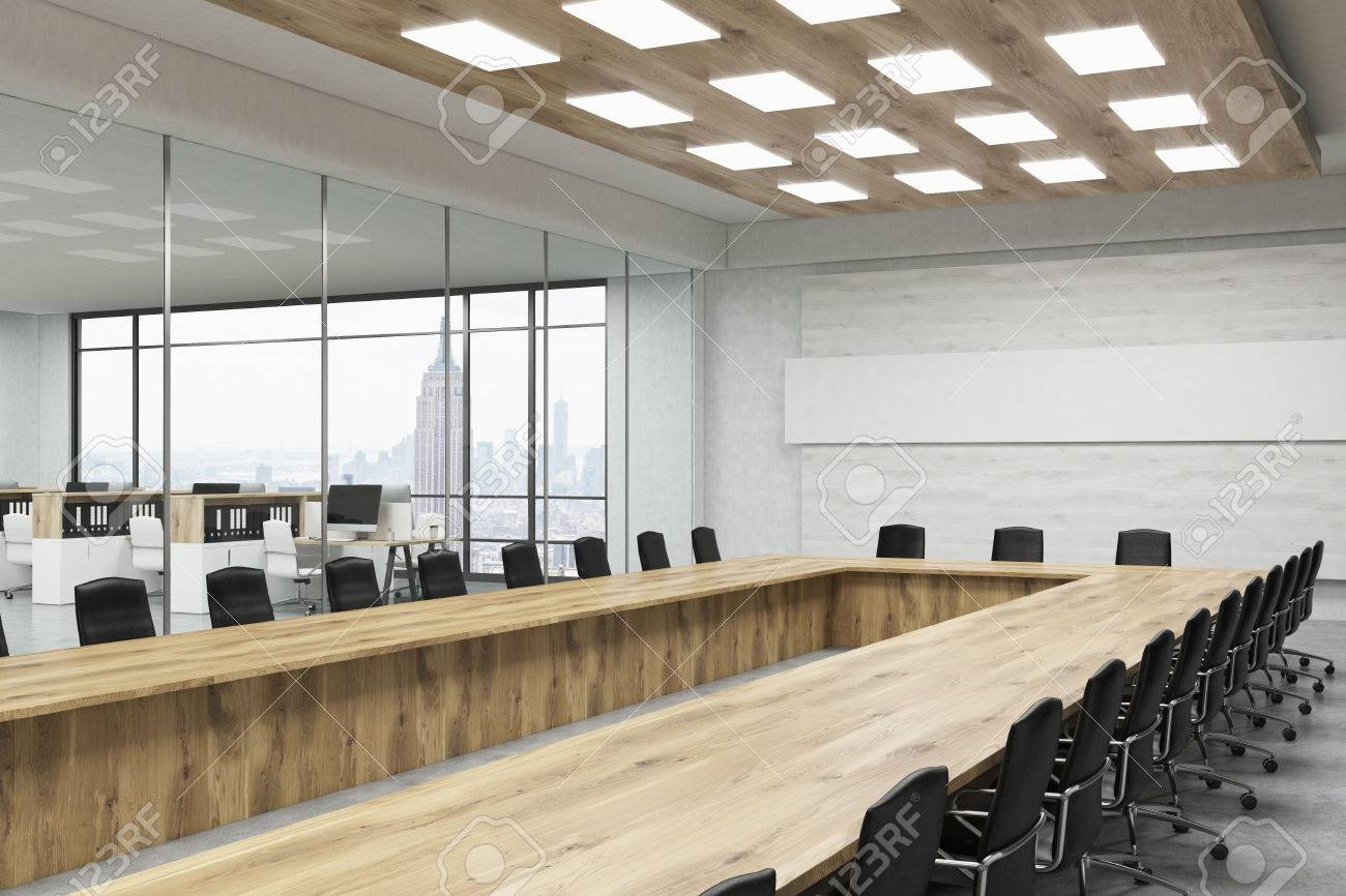 Board Room With Long Wood Table, Leather Chairs, Glass Wall, Poster And City