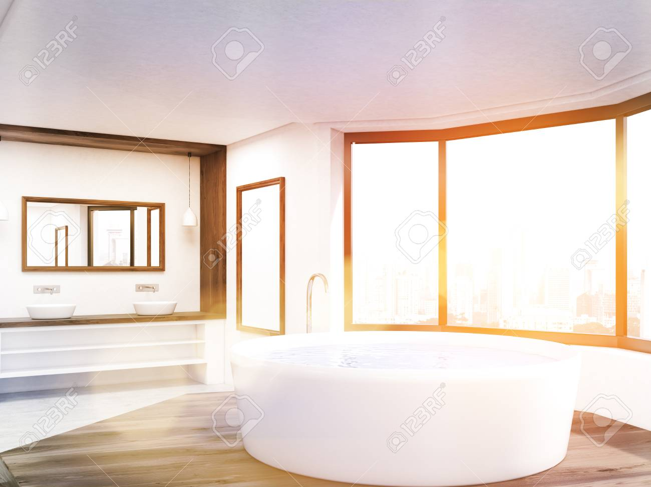 Sunlit Bathroom With Round Tub, Long Counter, Mirrors And Big Window.  Concept Of
