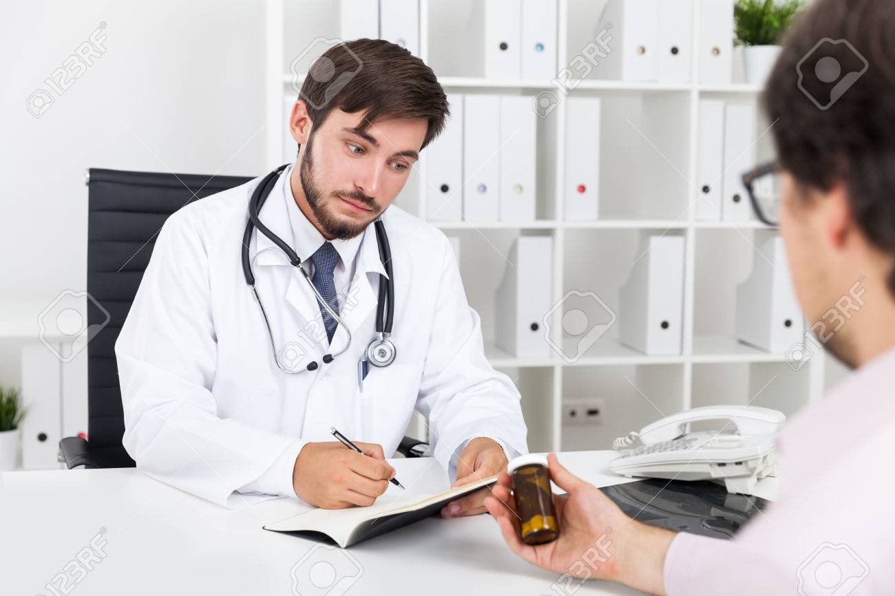 Concerned Doctor Is Listening To Pharmacys Representative Talking