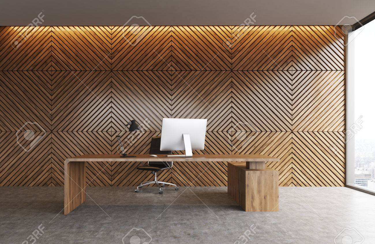 Office Table Made Of Wood Standing Against Wooden Wall Background