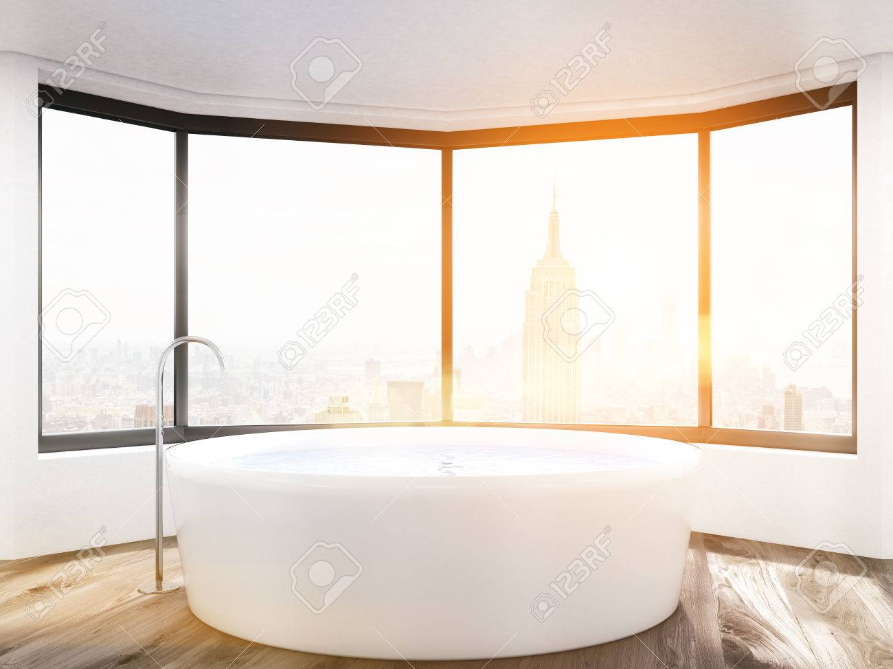 Sunlit Bathroom With Panoramic Window And Round Bath Tub. New ...