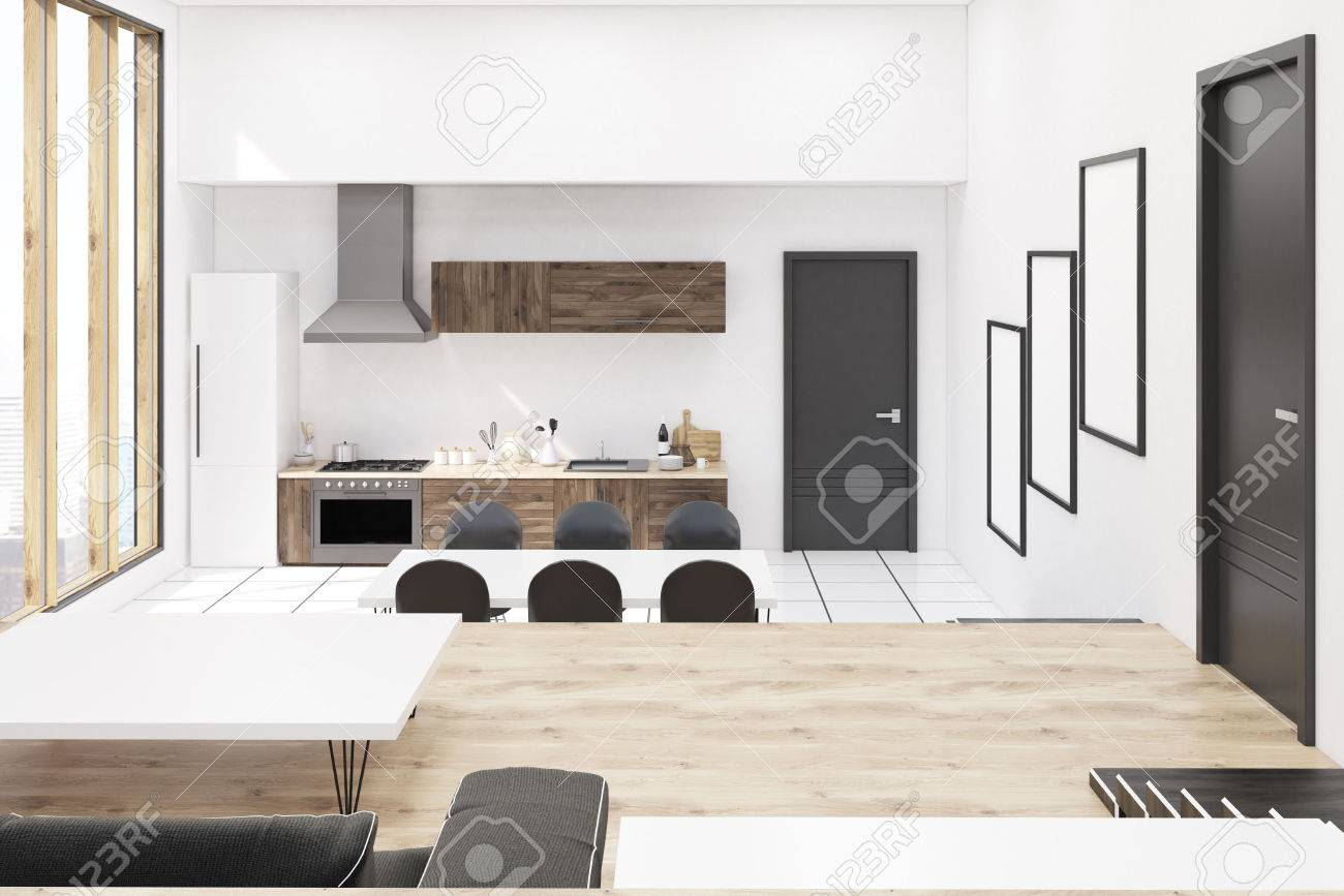 Front view of kitchen in modern studio apartment with panoramic..