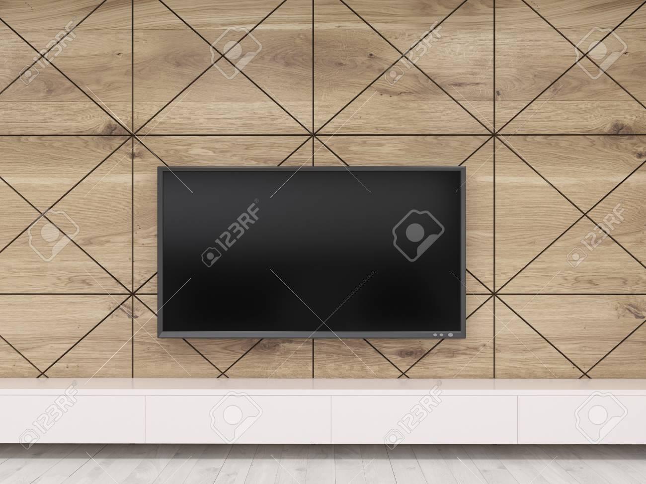 Gros plan du téléviseur sur le mur en bois suspendue au dessus