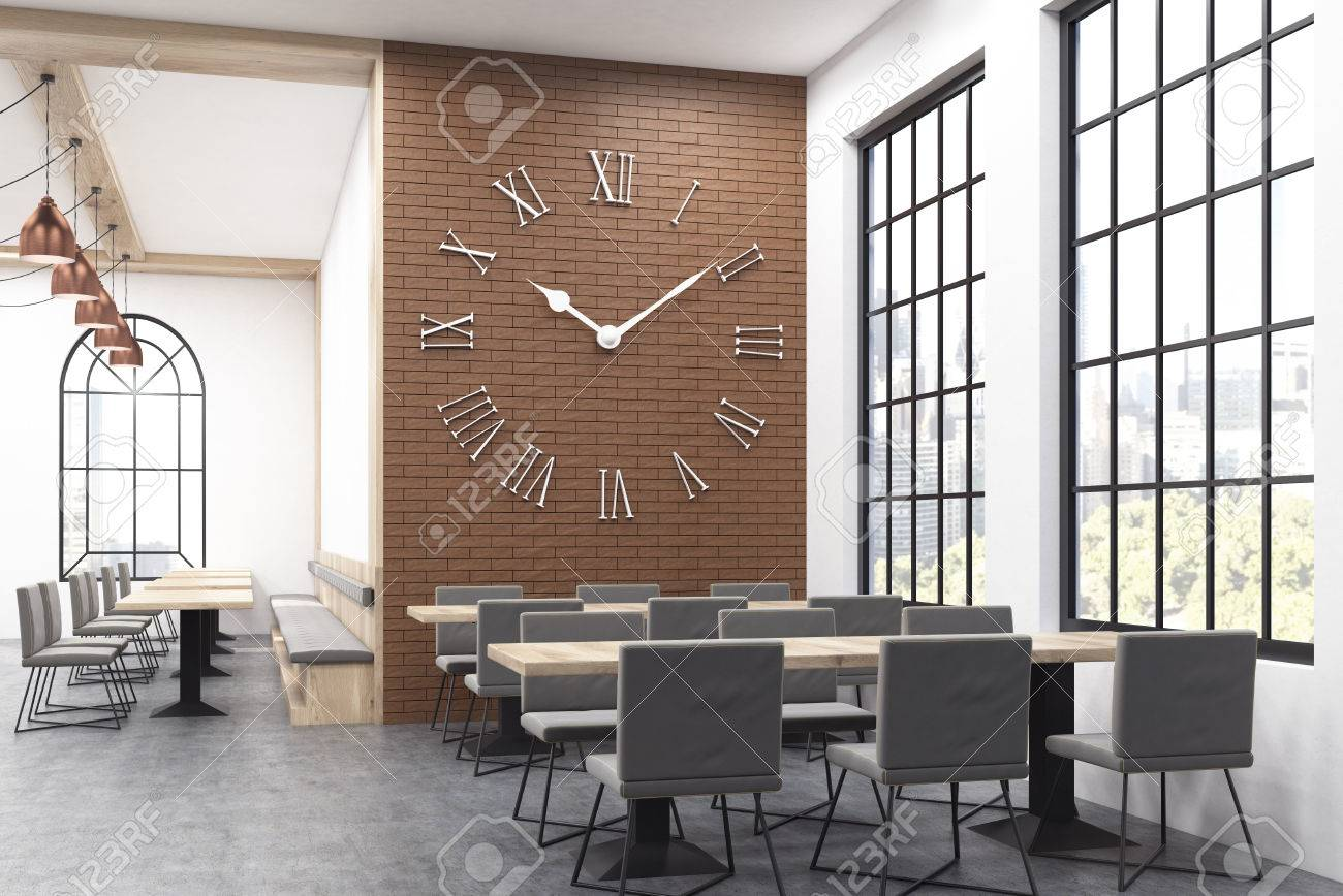 Restaurant Interior With Large Clock On Brick Wall And Long Tables Stock Photo Picture And Royalty Free Image Image 63651040